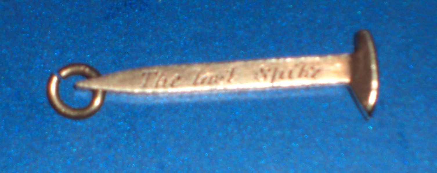 Miniature gold Spike, Courtesy of Mark W. Howe.