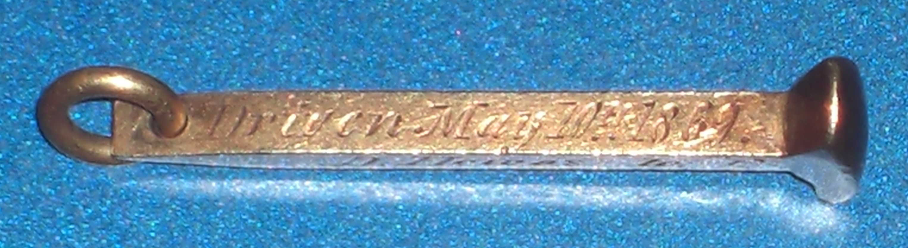 Miniature gold Spike, Courtesy of Mark W. Howe.